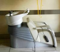Beim Haarewaschen eine kleine Massage